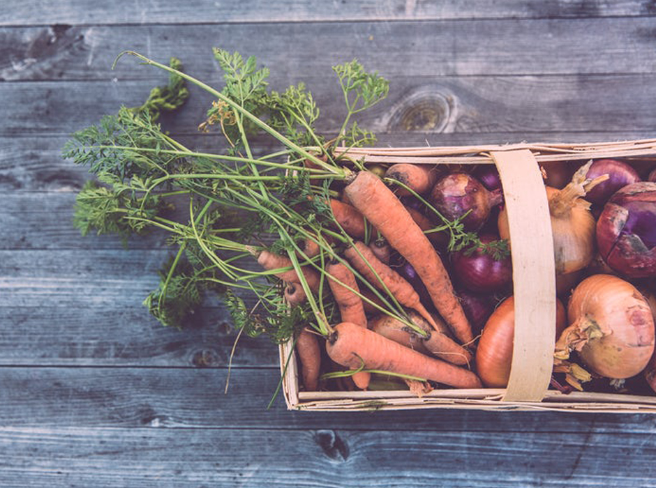 carrots radishes and onions in a basket