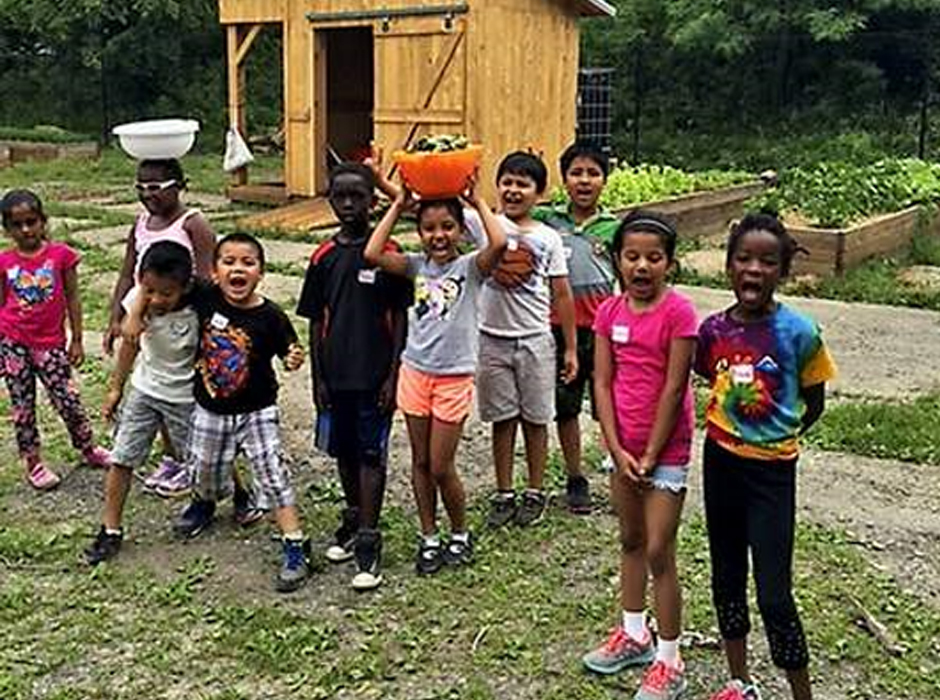 south hills interfaith ministries children gathered for gardening
