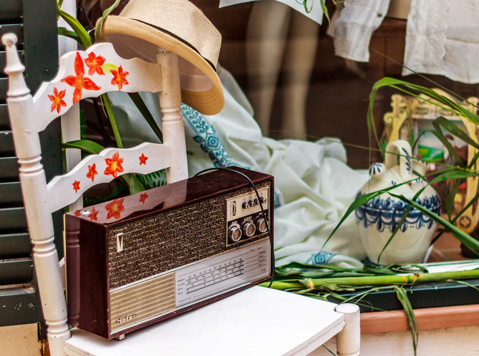 radio on a white chair with orange painted flowers